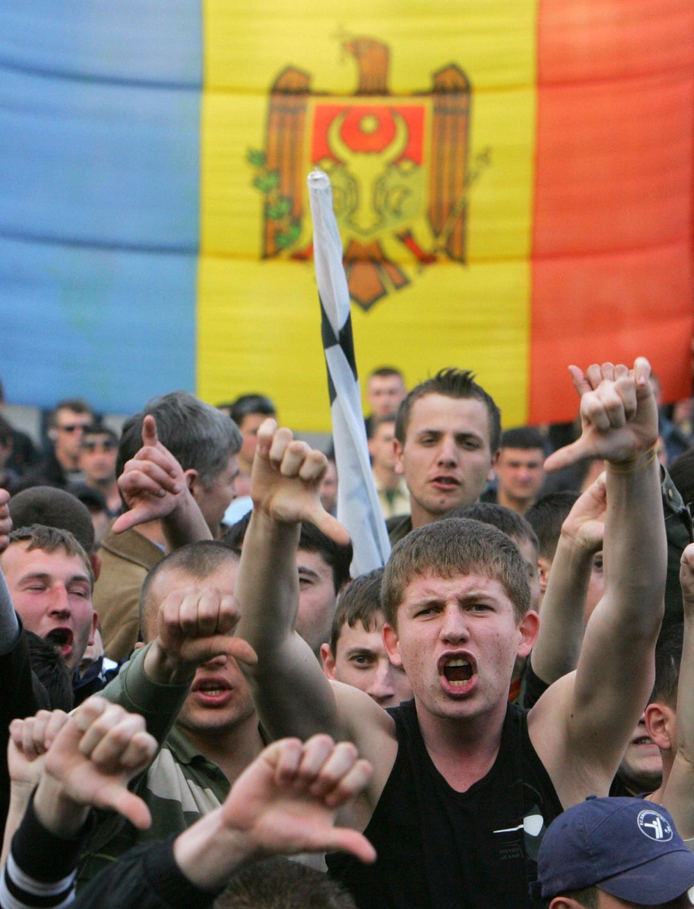 Protesters shout during a rally near a government building in Chisinau on April 8, 2009.