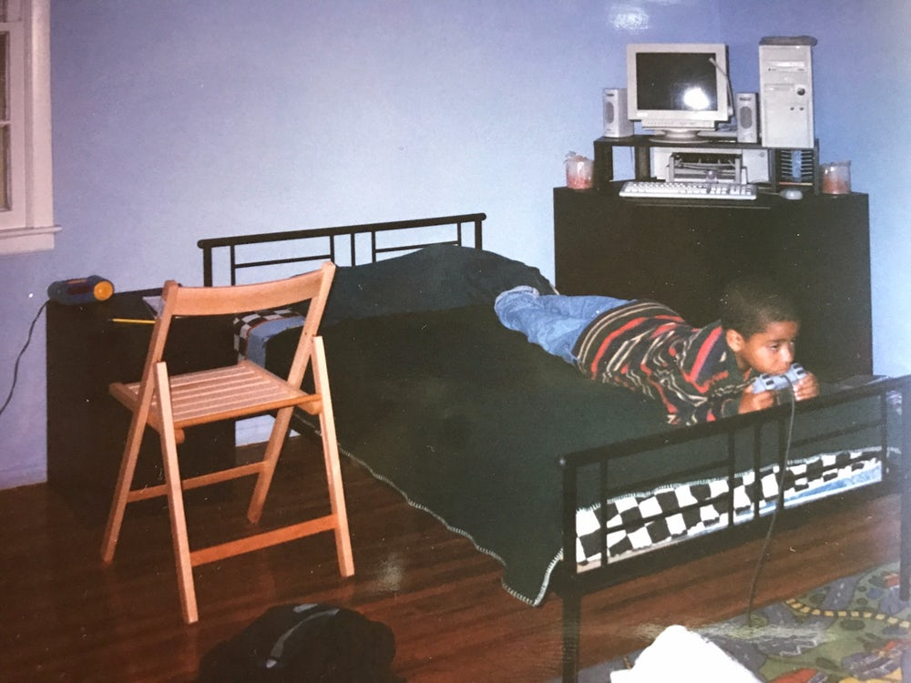 The author playing video games at 7 years old.