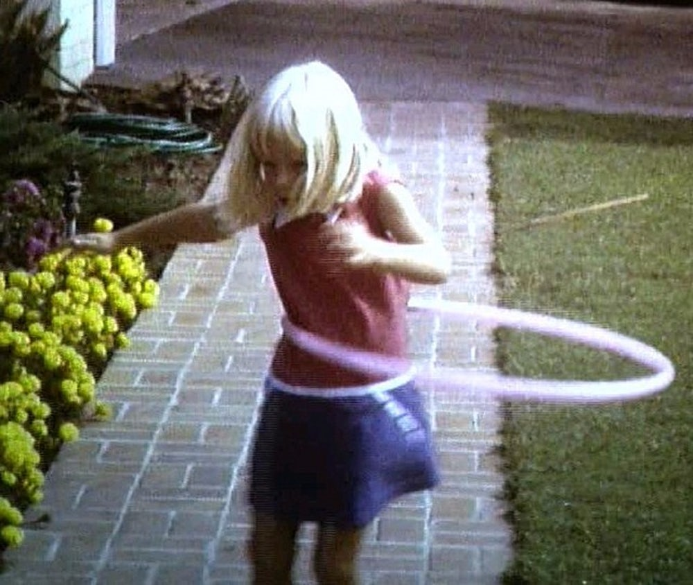 Home movie of hula hooping girl