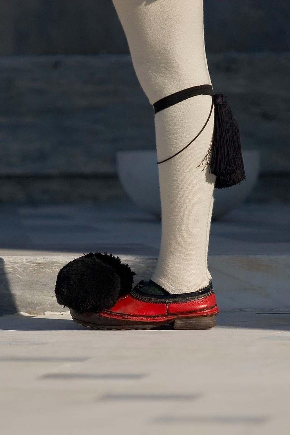 Greek tsarouhi shoes, which are part of regional dress and the traditional Greek guard uniform.