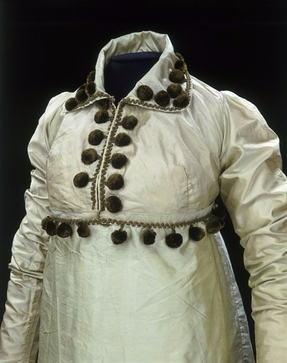 Dress from 1810 Great Britain with a pom-pom trim.