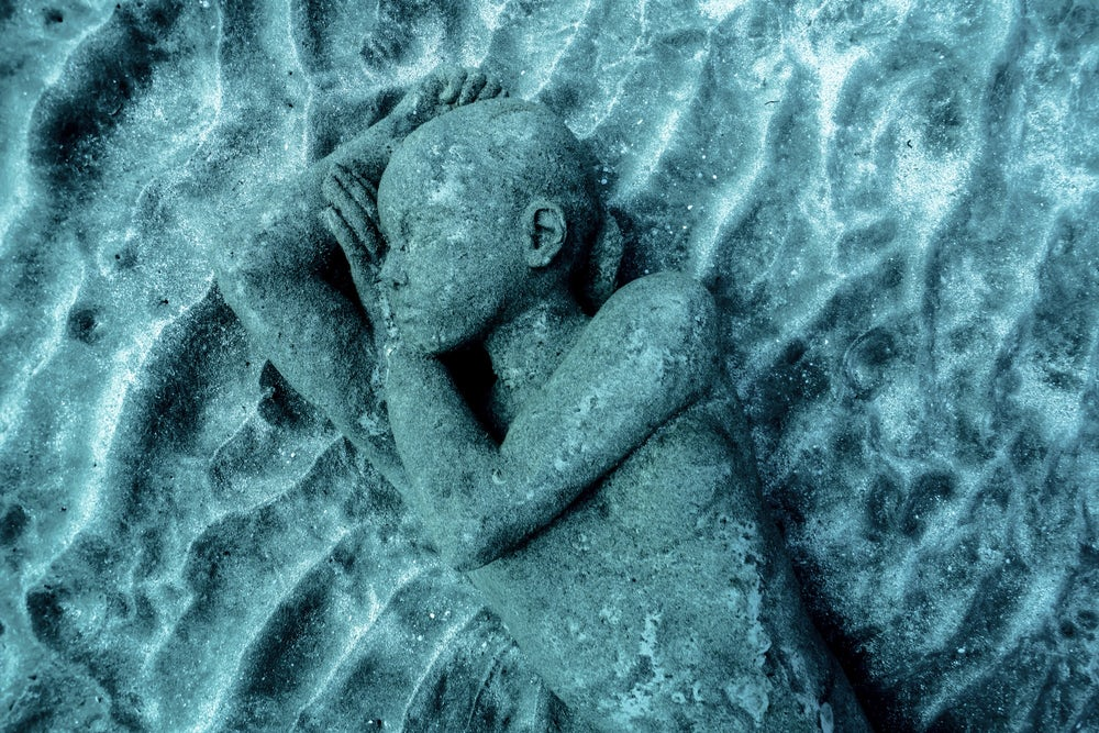 A statue cast from a local resident of Lanzarote lies on the seabed.