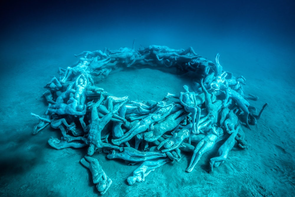 """""""The Human Gyre,"""" the final exhibit in the museum, consists of 200 figures which are arranged to encourage the growth of a large, circular reef."""
