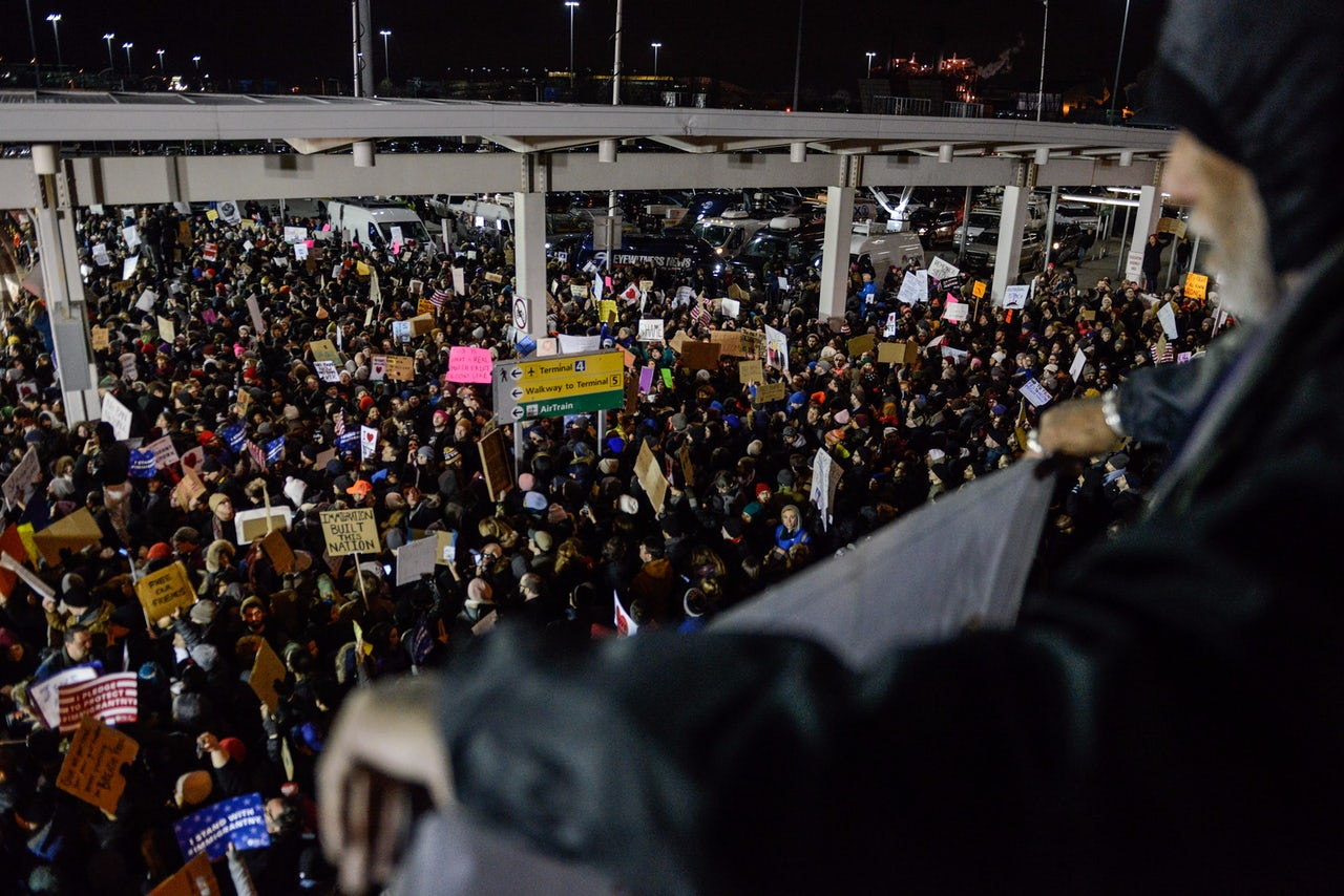 Protesters rally during a demonstration against the Muslim immigration ban at John F. Kennedy International Airport.
