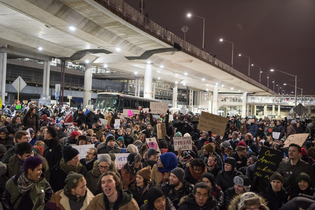Thousands fill the street outside Terminal 5 of O'Hare International Airport in Chicago.