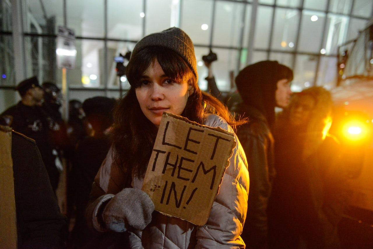 A protester at JFK.