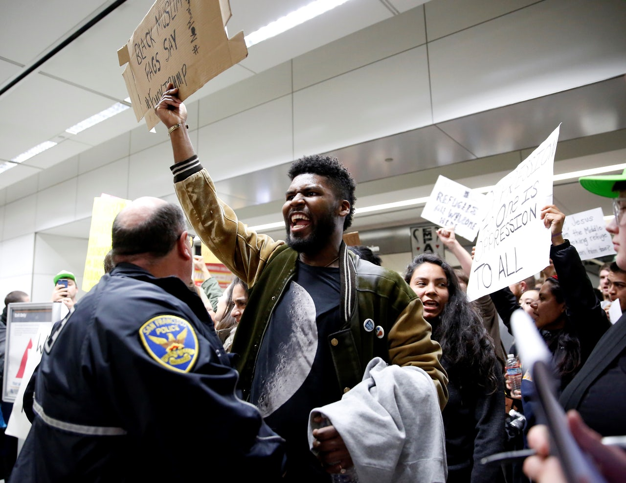 Activists stage a rally against President Donald Trump's 90-days ban of entry on 7 Muslim-majority countries at the San Francisco International Airport.