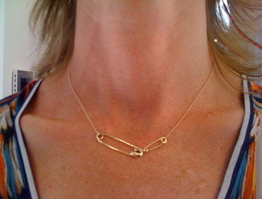 The infamous gold safety pin necklace.