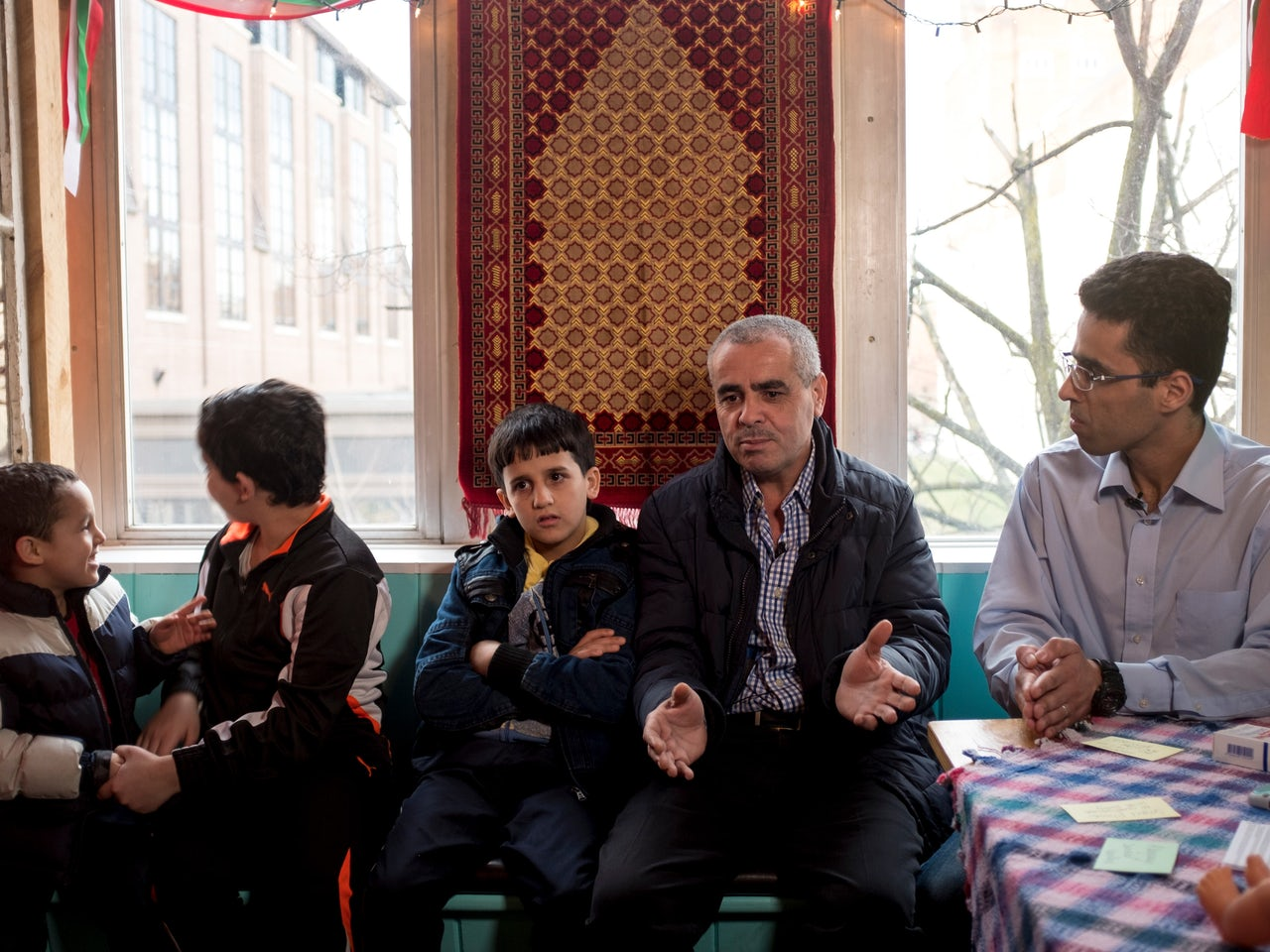 Mohammed Alghutani, center, a refugee from Syria, with his sons Moustafa, 5, Haroon, 12, and Ahmed, 10. Amer Alfayadh, a translator from Iraq, sits on the right.
