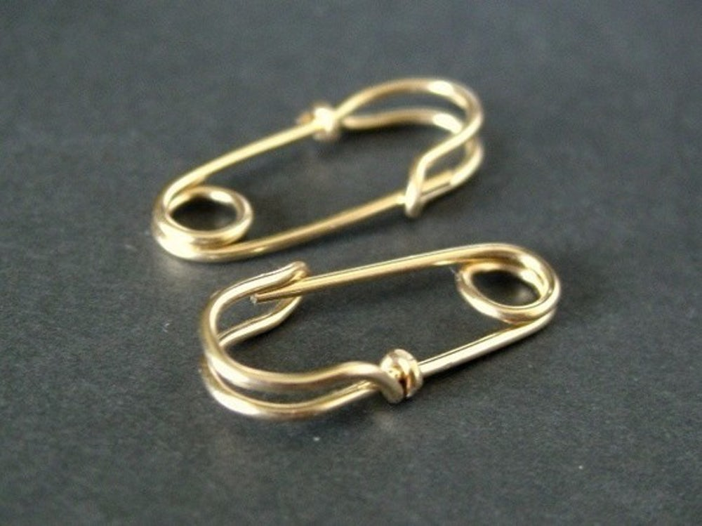 These earrings were inspired by punks who wore actual safety pins as necklaces.
