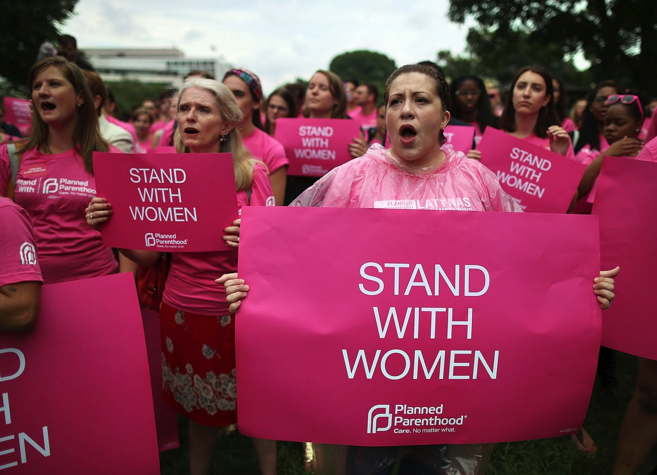 Women hold up signs during a women's pro-choice rally on Capitol Hill, July 11, 2013, in Washington, D.C.