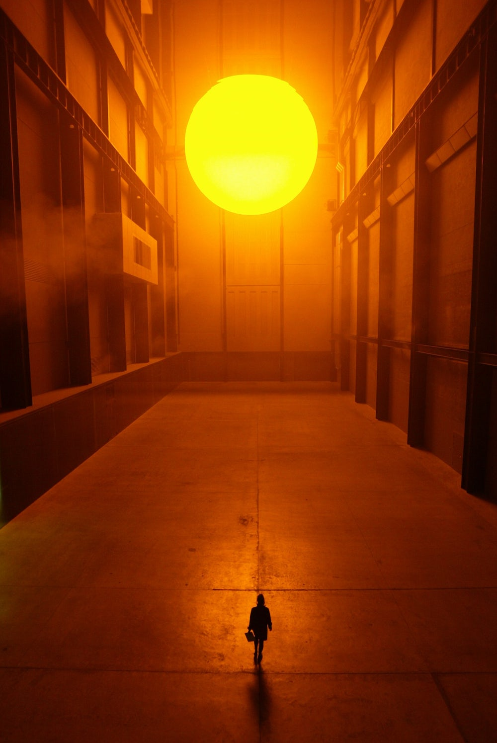 View of Olafur Eliasson's 'The Weather Project' installation at the Tate Modern gallery, London, England, 2003.