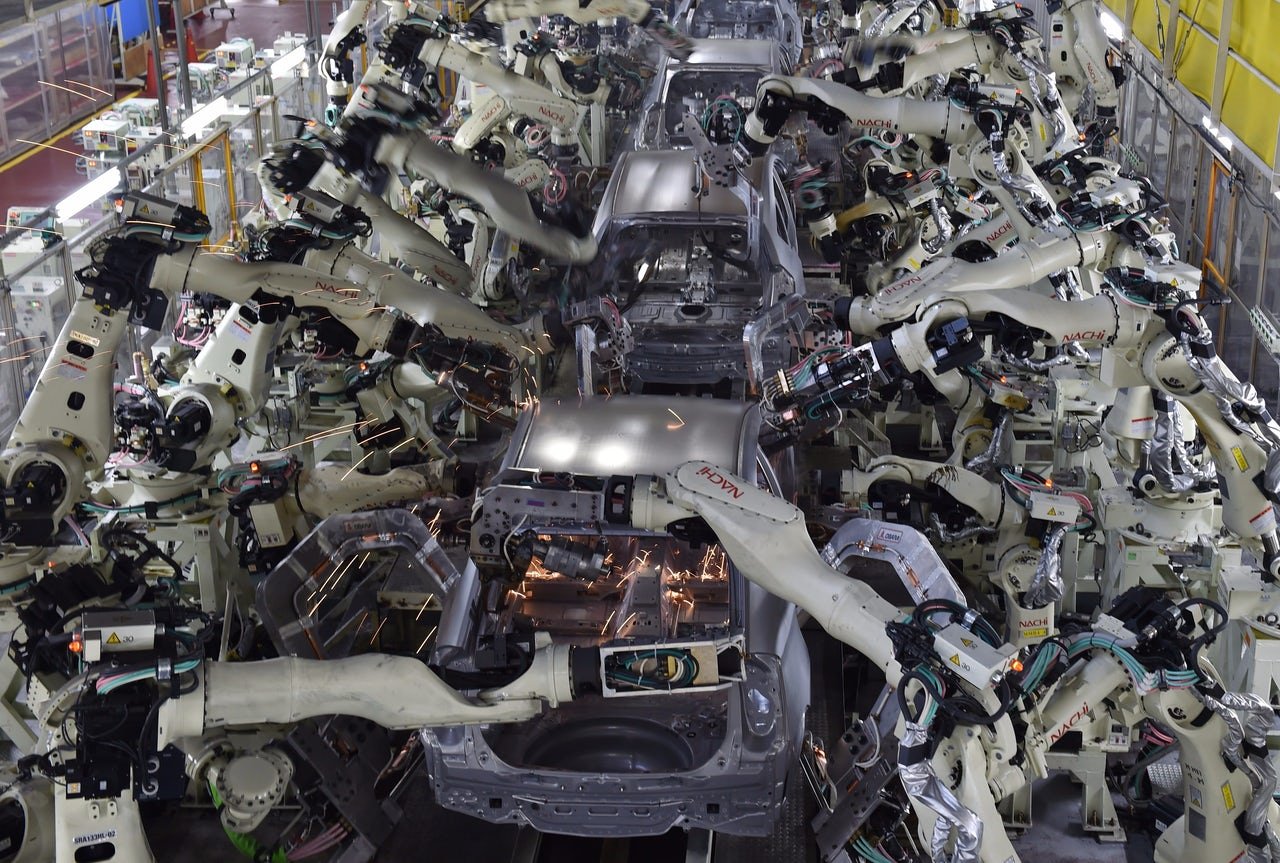 Automated welding machines assemble automobile bodies at Toyota Motor's Tsutsumi plant.