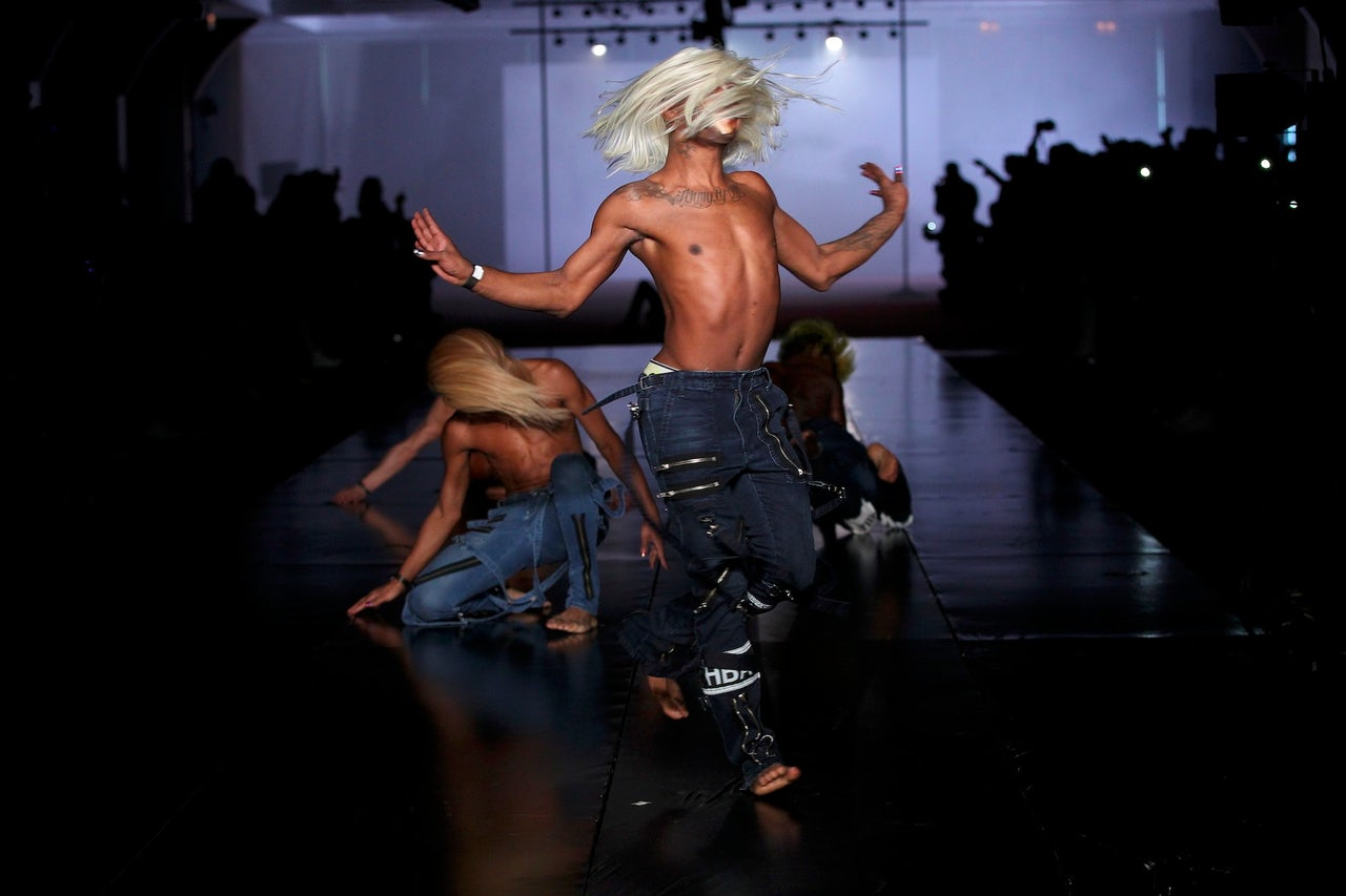 Models voguing at Hood By Air's Fall 2014 fashion week show.