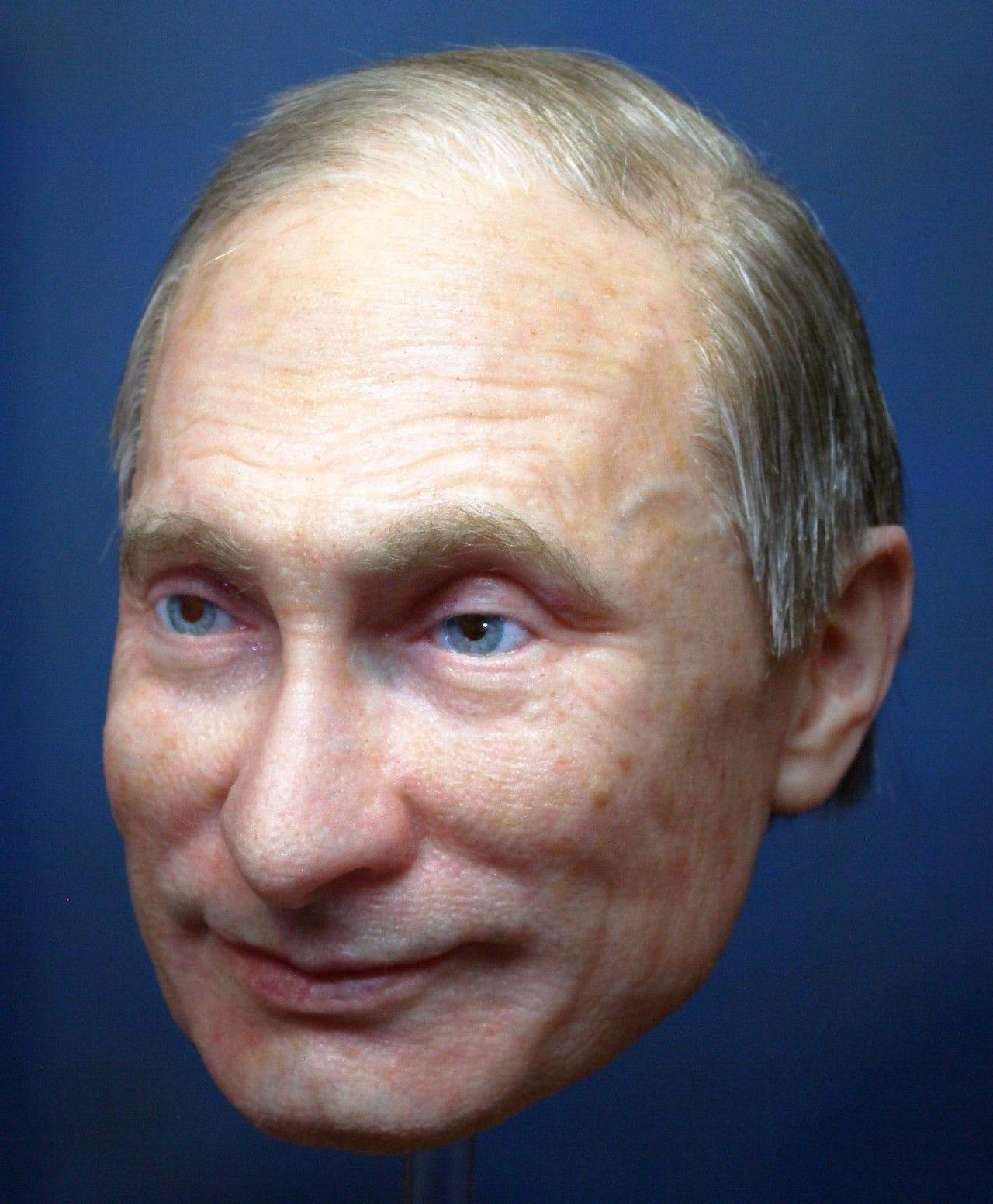 A realistic mask of Vladimir Putin.