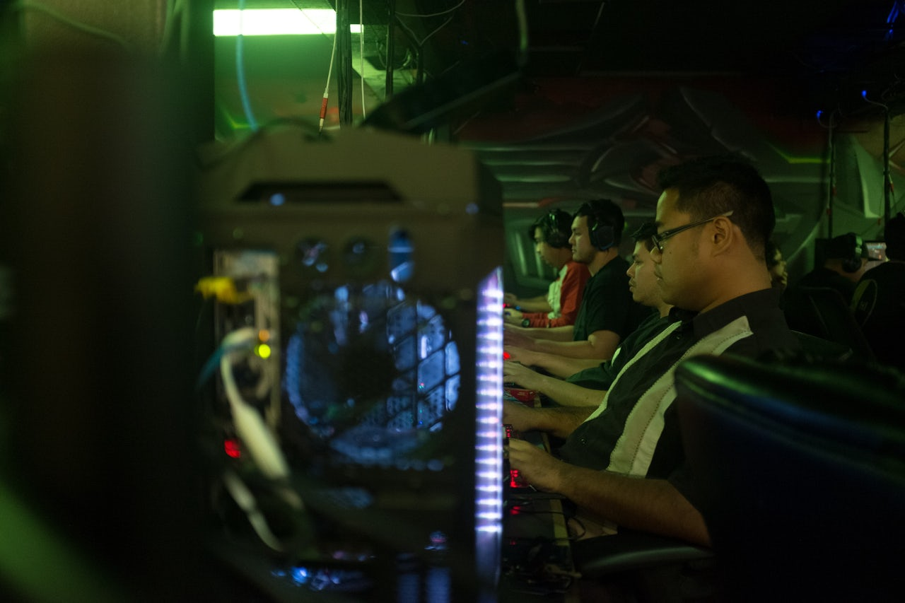 League of Legends players intent on their screens at PC Gamerz in Honolulu.