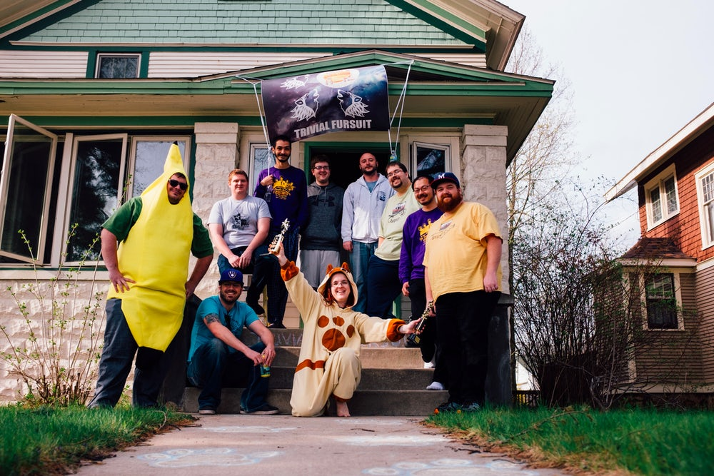 Members of Trivial Fursuit stand in front of their headquarters in Stevens Point, Wisconsin.