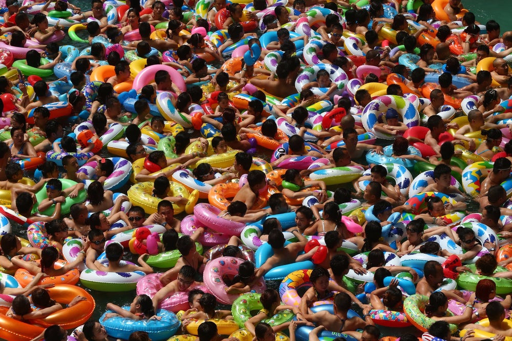 People in innertubes swimming at a waterpark in Suining, China.