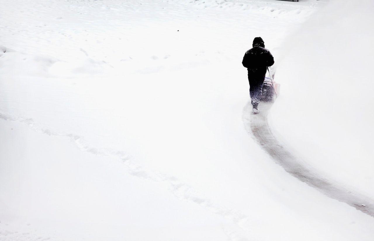 A man plows snow in Millennium Park in Chicago.