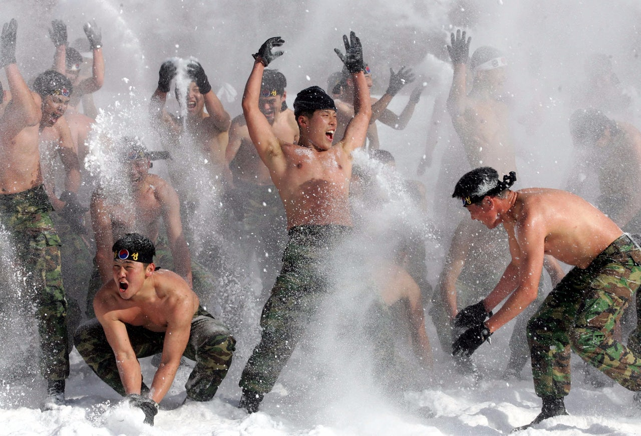 Soldiers play in the snow in PyeongChang, South Korea.