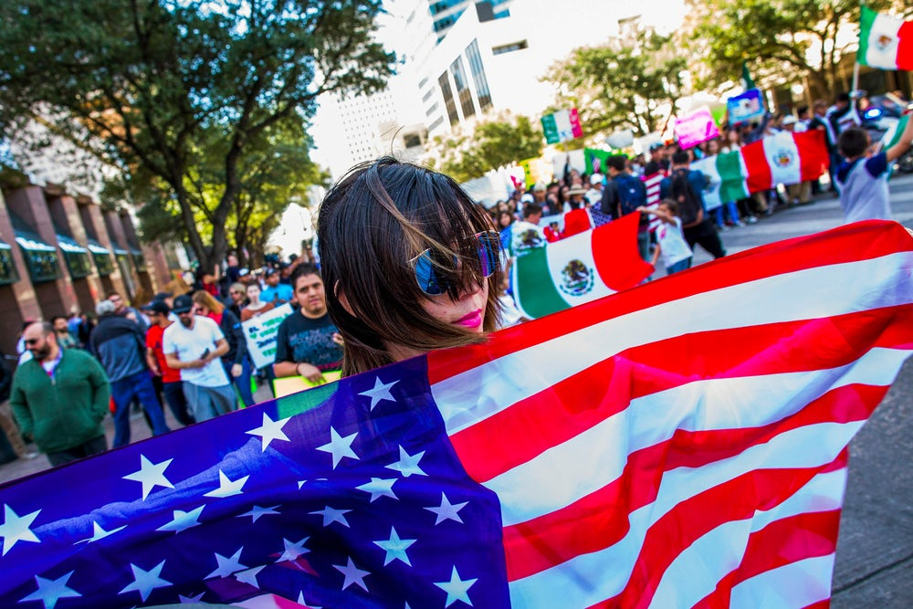 'A Day Without Immigrants' demonstrators march outside the Texas State Capitol on February 16, 2017.