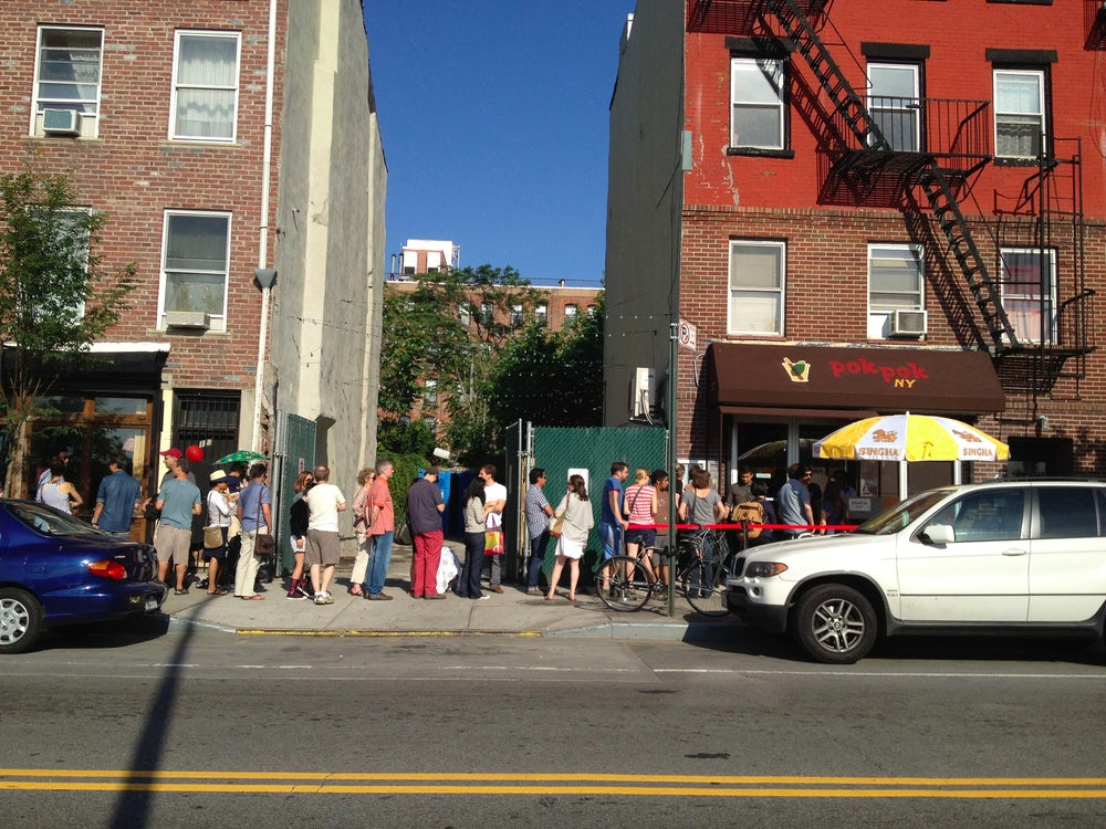 Around 40 people line up outside of Pok Pok, a northern Thai restaurant in New York. Founder Andy Ricker is often accused of cultural appropriation.