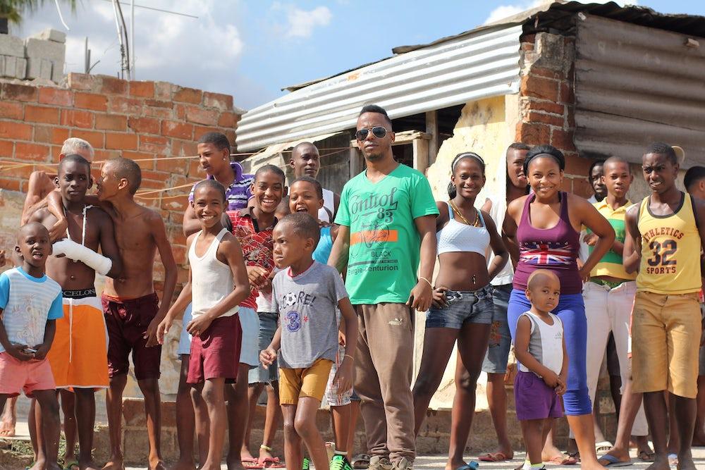 Bakosó artist Ozkaro hangs out in his neighborhood in Santiago de Cuba.