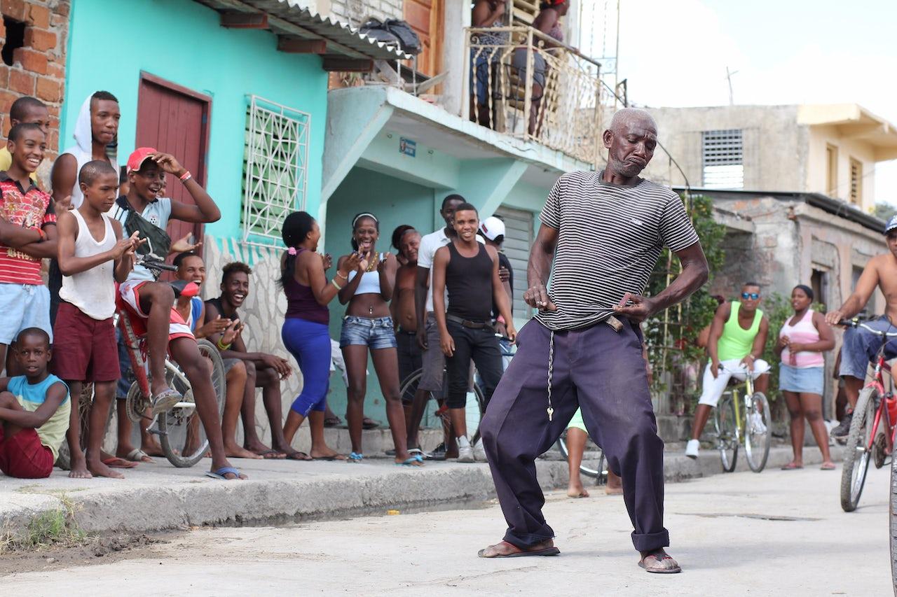 A man dances in the streets of Santiago de Cuba.