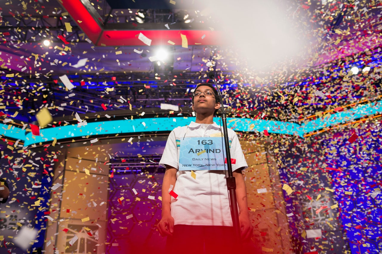 Arvind V. Mahankali stands in falling confetti after winning the 2013 Scripps National Spelling Bee.