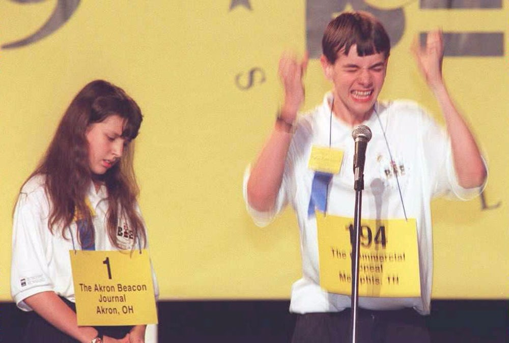 Justin Carroll (R) celebrates winning the Scripps Howard National Spelling Bee over competitor Marjory Lazery. Carroll's winning words were 'Hirumvine' and 'Xanthosis'.