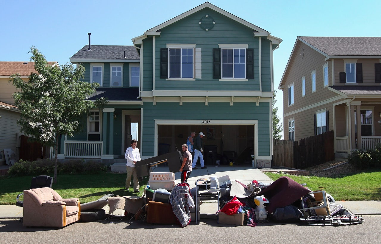 An eviction team moves furniture from a home to the curb during a 2011 foreclosure in Longmont, Colorado.