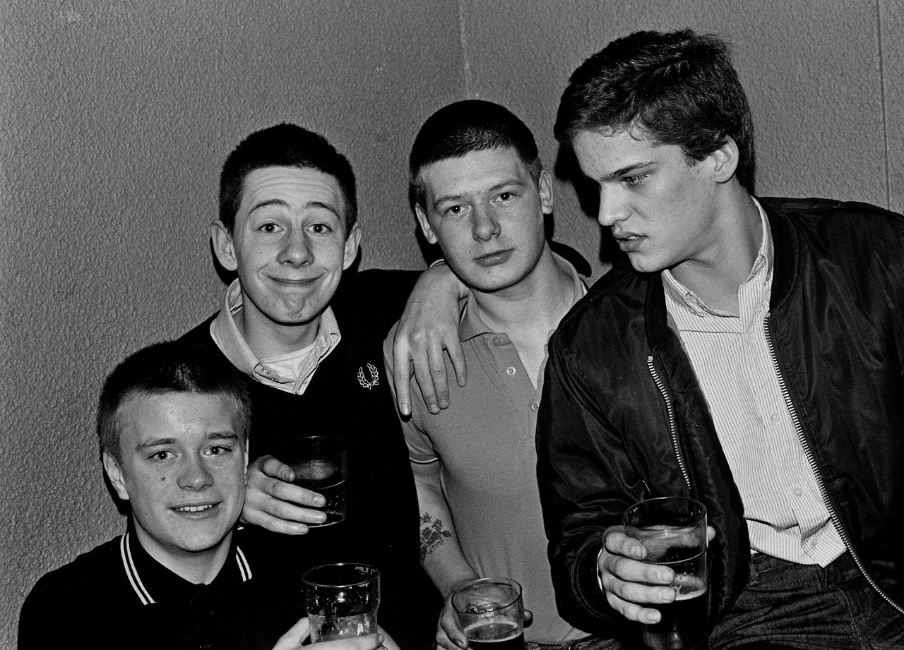 Young skinheads wear Fred Perry at a gig in 1981.