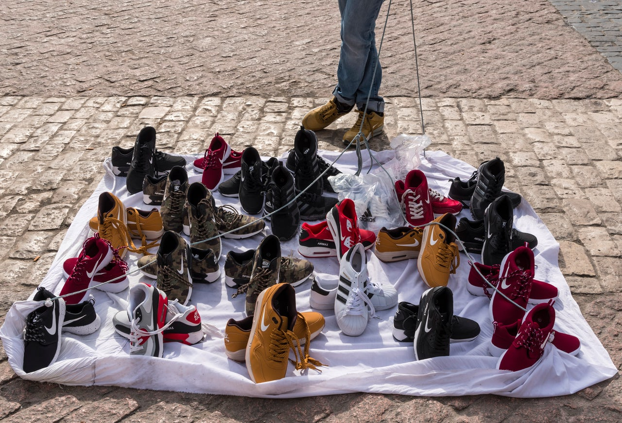 A vendor in Madrid sells counterfeit Nike shoes.