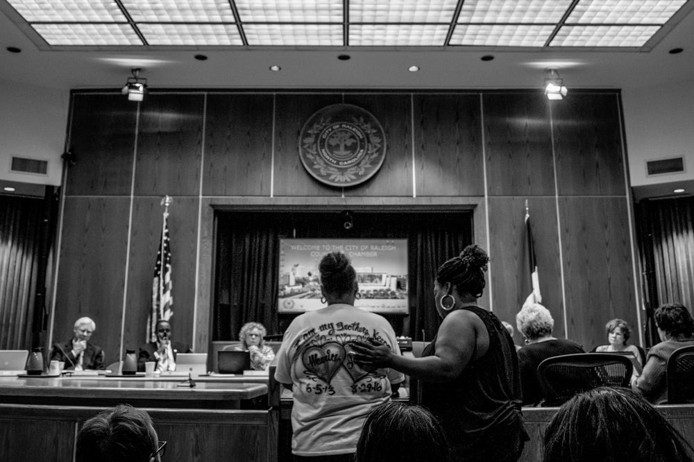 Aisha Flood and Rolanda Byrd at the Raleigh council meeting on March 7.