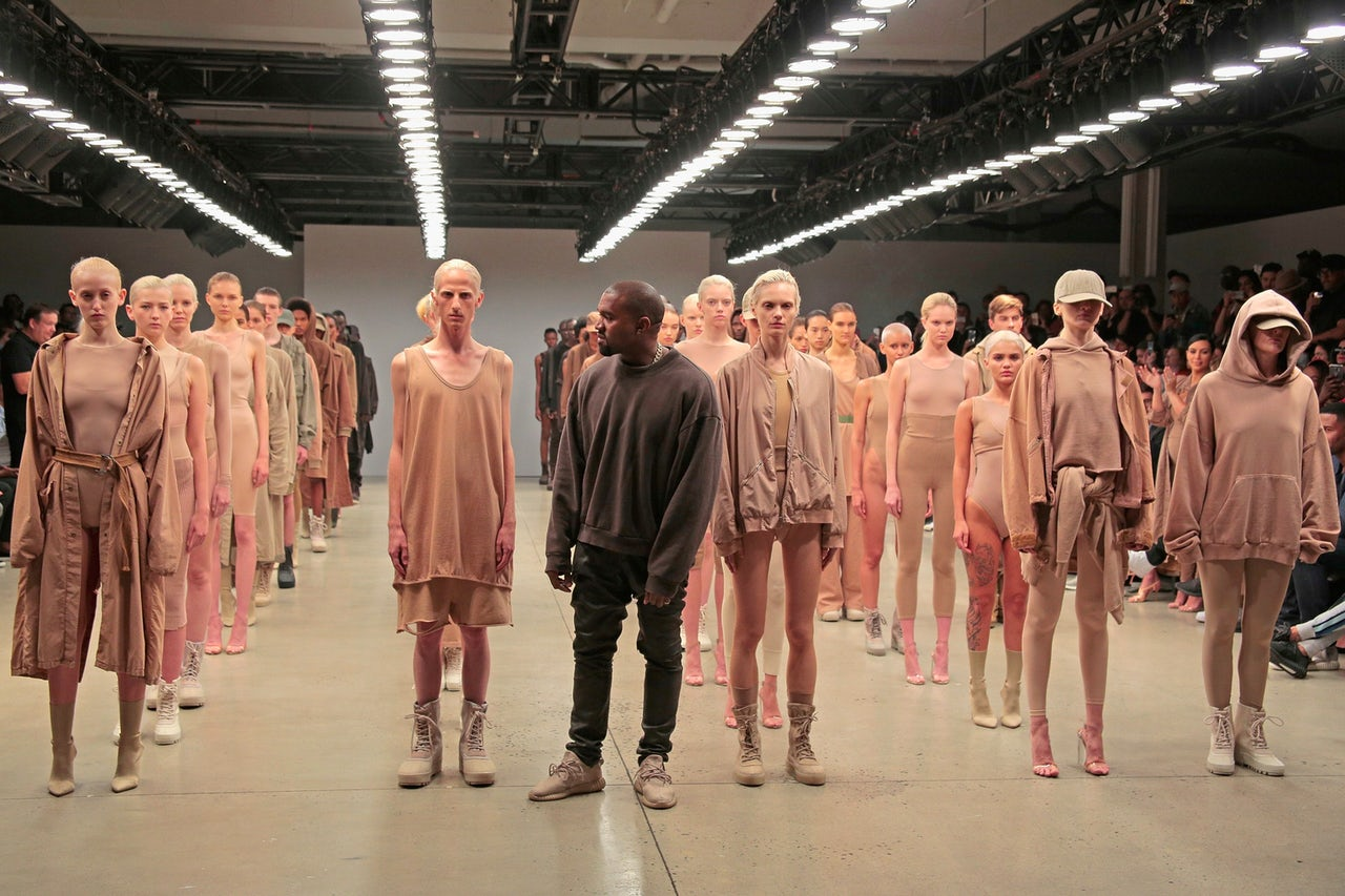 Kanye West and models during Yeezy Season 2 in 2015. West's fashion collections have been criticized in the past for lacking originality.