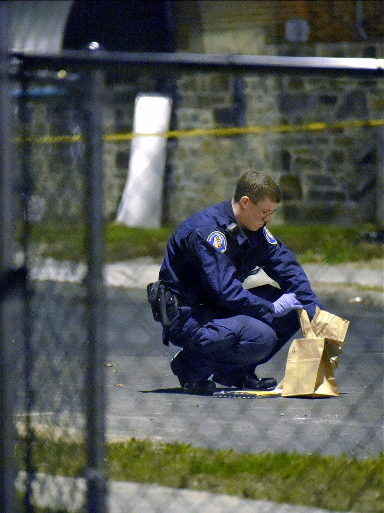 A crime lab technician investigating a fatal stabbing in Baltimore.