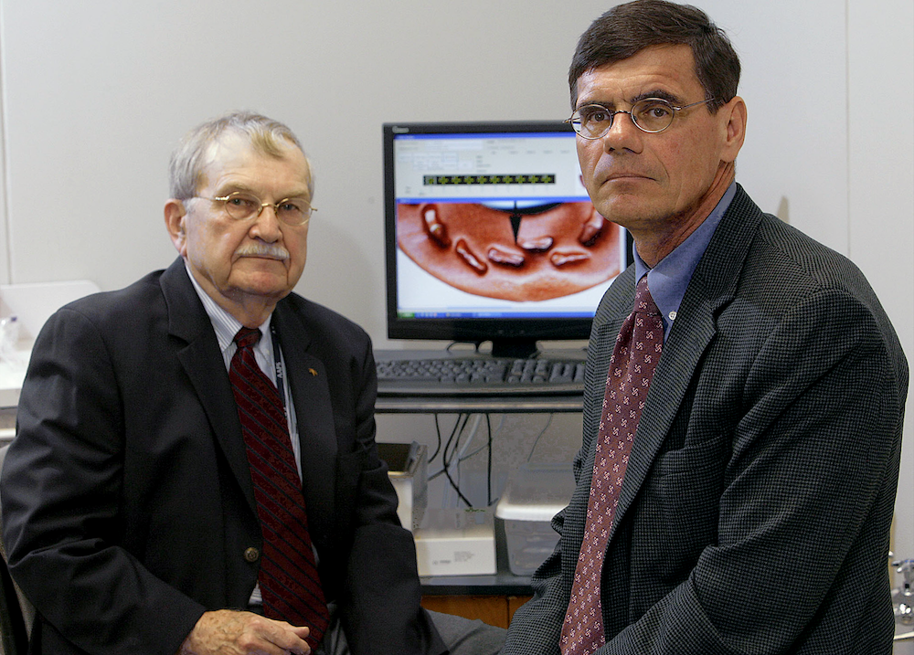 Dr. Lowell Thomas Johnson, a forensic odontologist at Marquette University and law professor Daniel Blinka (right), worked together on the first criminal case in Wisconsin to use bite mark evidence in Milwaukee, Wisconsin, June 11, 2008. Johnson's testimony led to a murder conviction that was later overturned with DNA evidence.