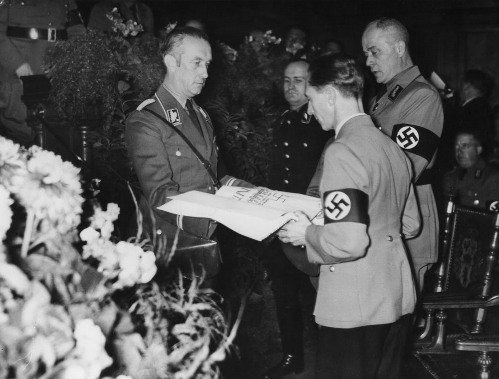 Joseph Goebels receives an oversized check in 1936, in what may be the earliest archived photo of such a check.