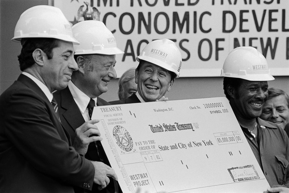 Ronald Reagan presents then New York Governor Mario Cuomo and NYC Mayor Ed Koch with a giant, $85 million check in 1981.