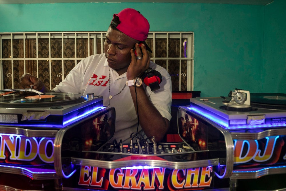 DJ Sisi spins records at the El Gran Che picó in Barranquilla, Colombia.