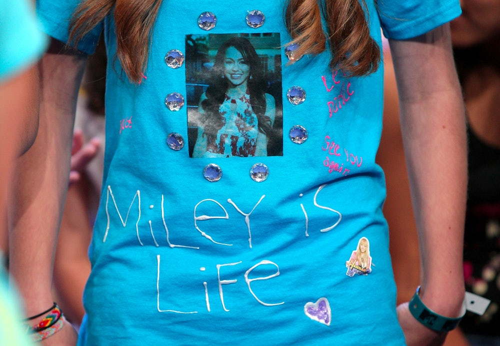 A fan wears a homemade Miley Cyrus t-shirt during the singer's appearance on MTV's TRL in 2008.