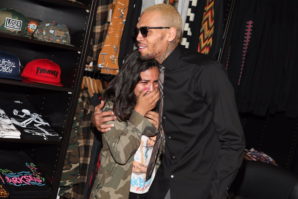 A fan cries while meeting Chris Brown in 2013.