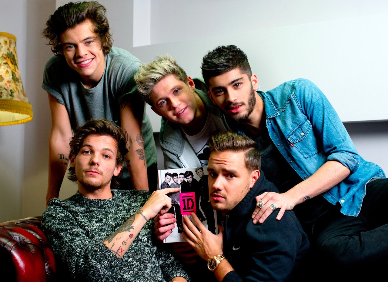All five members of One Direction attend a book signing in 2013.
