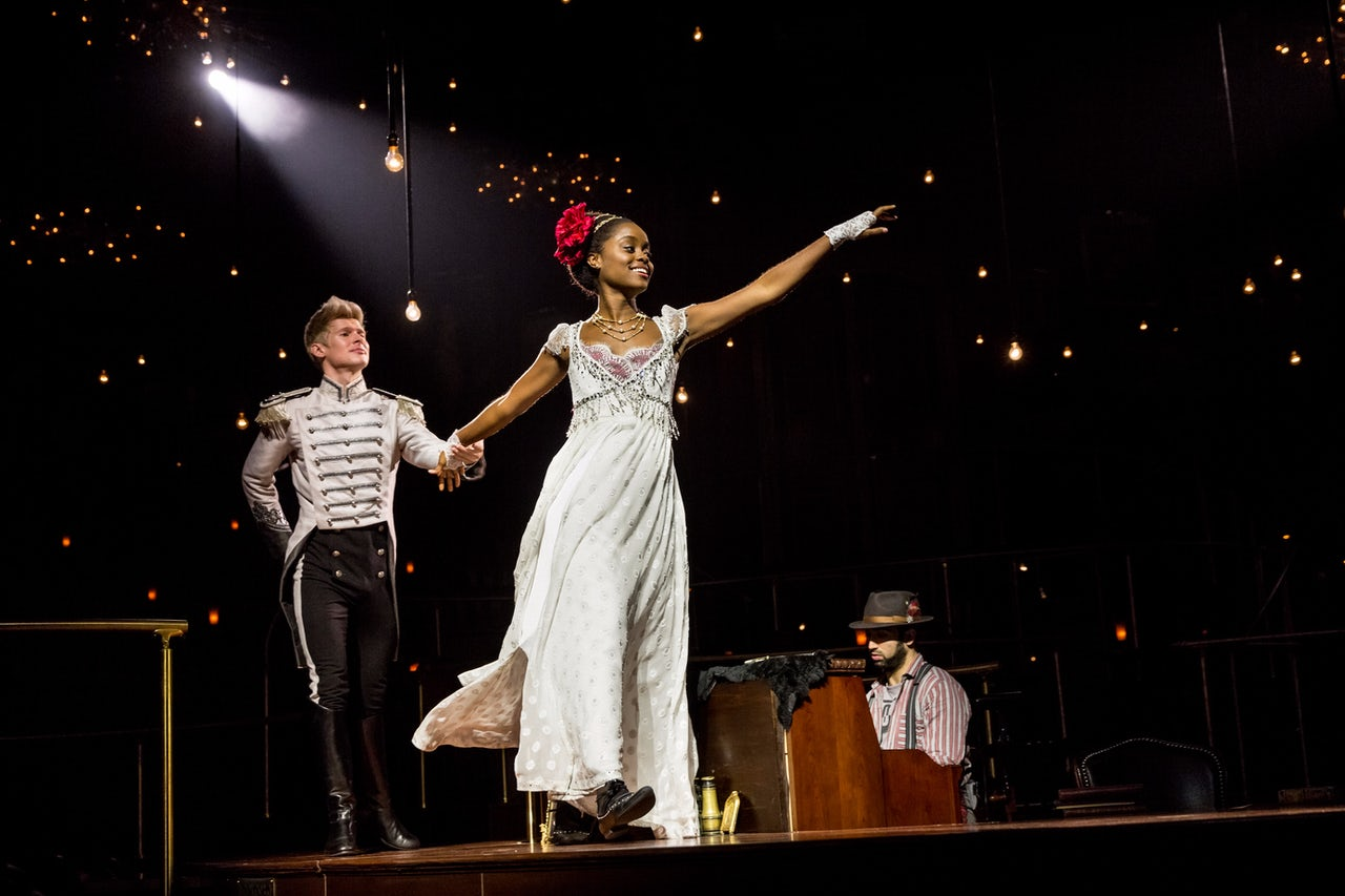 Lucas Steele as Anatole and Denée Benton as Natasha.