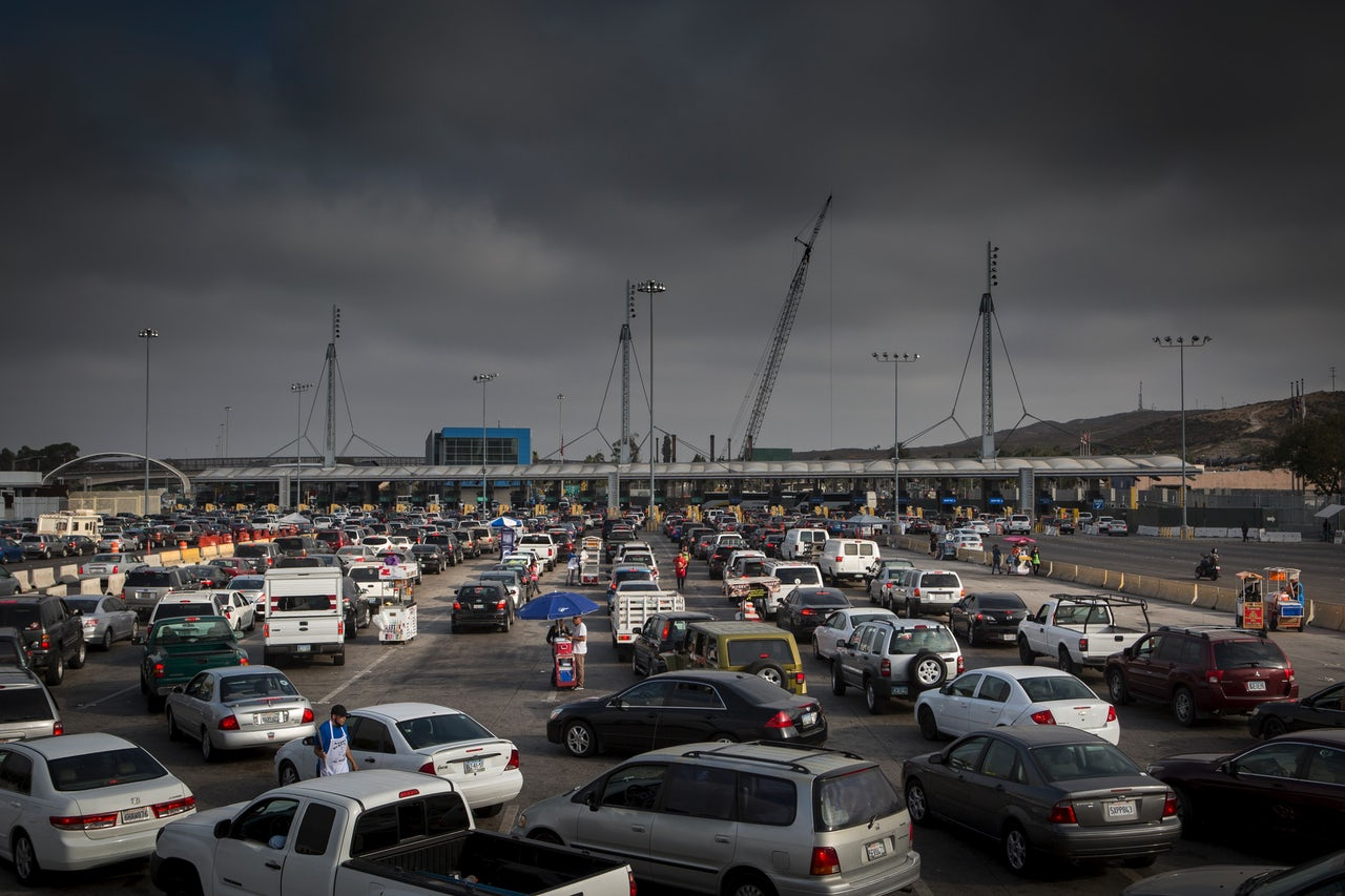 Thousands of commuters and travelers cross over the San Ysidro border crossing every day, making it the busiest border crossing in the world. On the Tijuana side, the line to cross starts as early as 3 a.m.