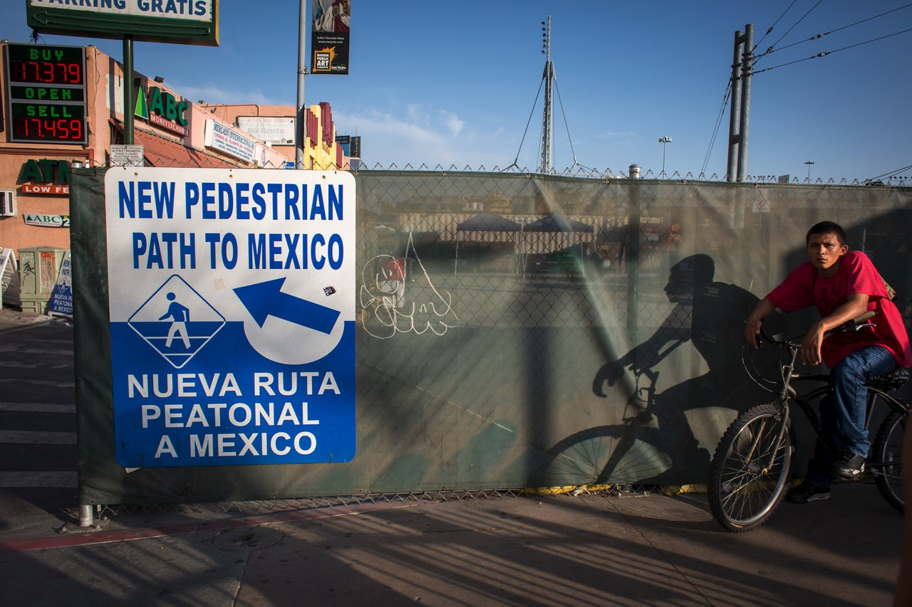 A sign points to the pedestrian San Ysidro border crossing from the U.S. into Tijuana, Mexico.