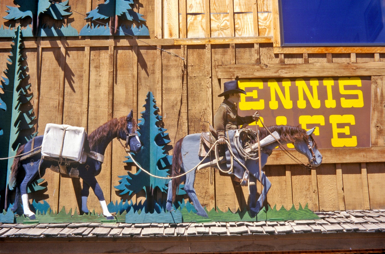 A Western scene decorates the exterior of the Ennis Cafe in Ennis, Montana.