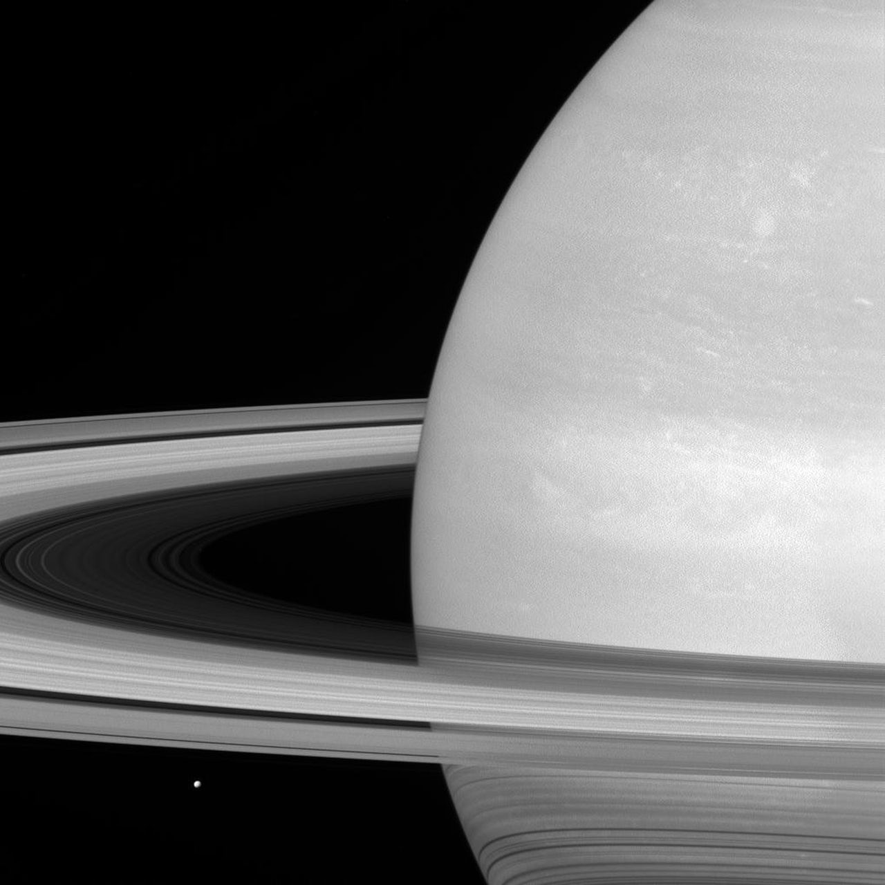 Saturn's rings, which are made of small, icy particles spread over a vast area, are generally no thicker than the height of a house.
