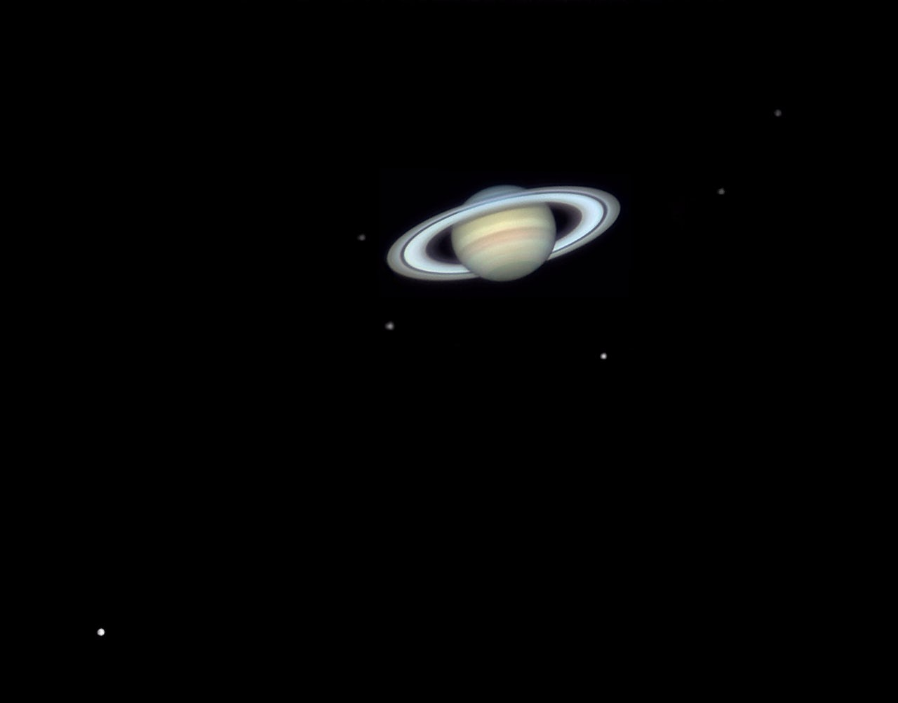 Saturn and six of its moons.