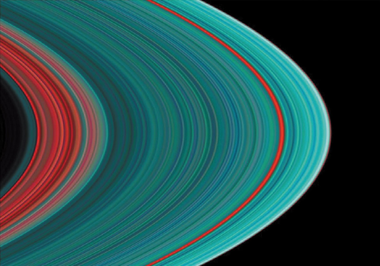 An ultraviolet image of Saturn's rings. Ringlets shown in turquoise have a greater concentration of frozen water than those shown in red.